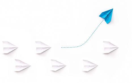 tiny_blue_paper_airplane.jpg