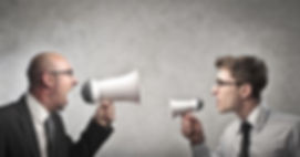 two people shouting at each other in a workplace conflict, using workplace mediaion to resolve their dispute