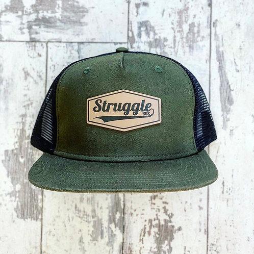 Struggle Bus leather patch on olive green snapback with black mesh back