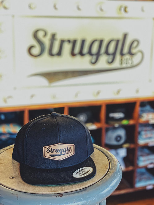 Struggle Bus leather patch on solid black snapback