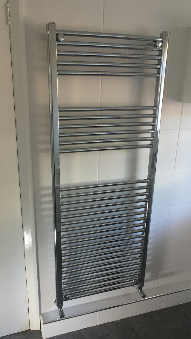 As you can see we installed a nice chrome towel radiator making sure to make the plumbing as neat as possible.