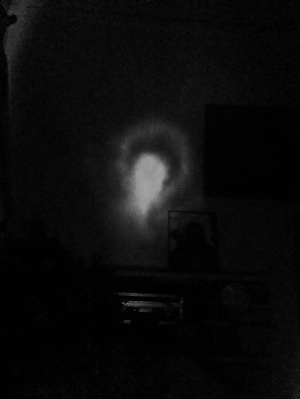 My mother's portrait and the manifestation of her Spirit beside it, I awaoke to this one morning around 5am.