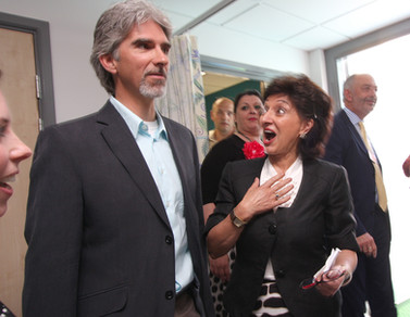 A fan meets racing driver Damon Hill at St Georges Hospital.