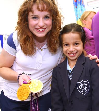 Double gold metal winner Natasha Baker MBE mets a fan at child delvelopment unit.
