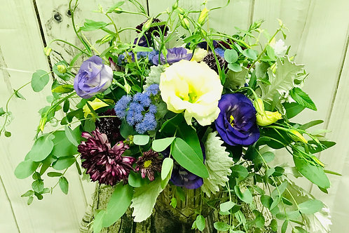 Purples, creams, greens and whites in a vase