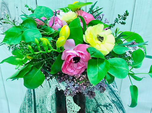 Pinks and Yellows and greens in a vase