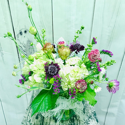 pinks, purples and whbites in a vase