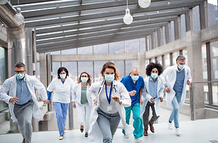 Group of doctors with face masks running