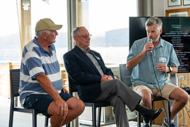 Life Members and past Commodores Ross Walker and John Christie regail the crowd with anecdotes from the past and the history of the previous Worser Bay Boating Club buildings