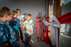 Worser Bay Boating Club President cuts the ribbon to declare the new building open