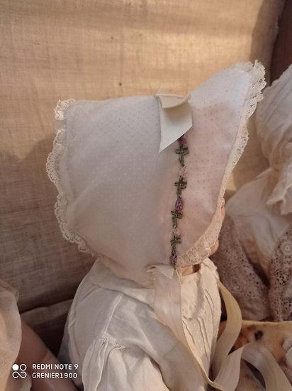 Charmant bonnet d'enfants rose pâle