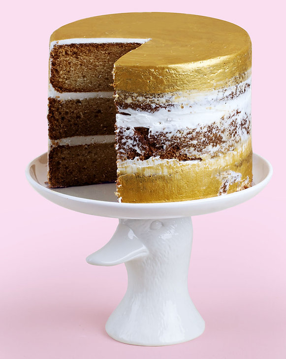 Gold and White Cake on a Stand
