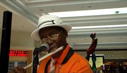 "Les playing flute ""Oye Como Va"", in the Port Charlotte Mall, FL"