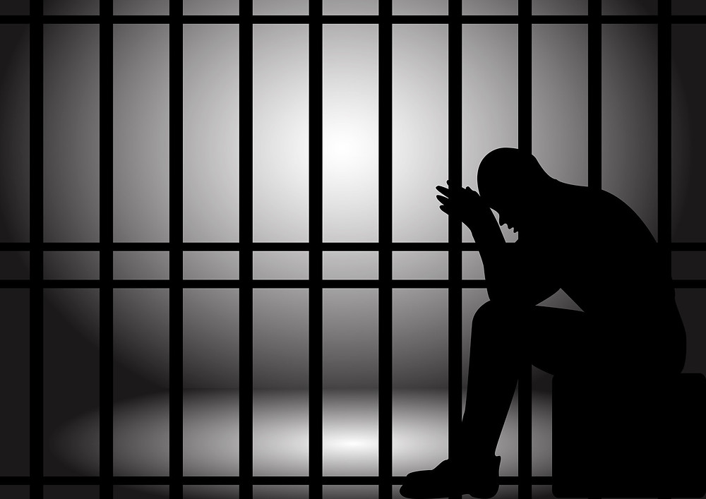 An image of a person in jail. Image taken from http://laschoolreport.com/teachers-union-talking-strategy-for-combatting-teacher-jail/
