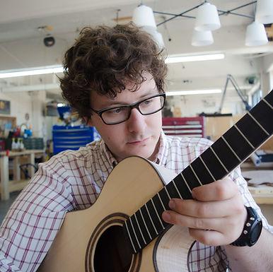 Vincent Cléroux inspects a newly built guitar