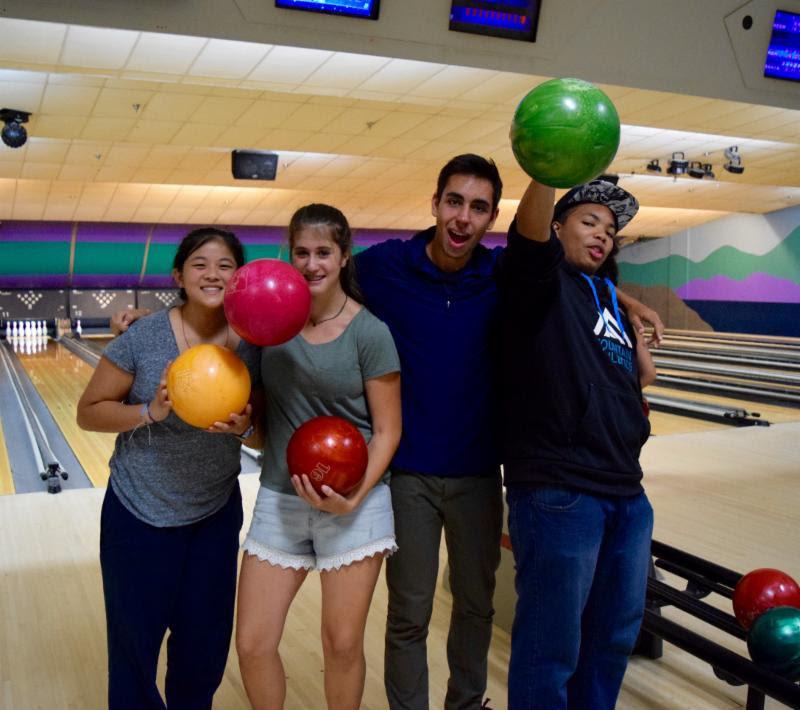 Junior counselors enjoying an evening of bowling