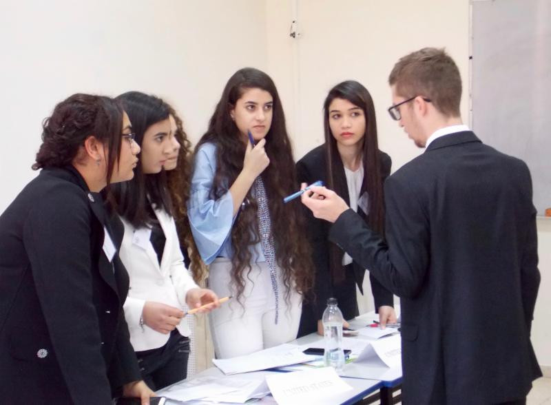 MUN Security Council teens discussing resolutions on the Israeli-Palestinian conflict