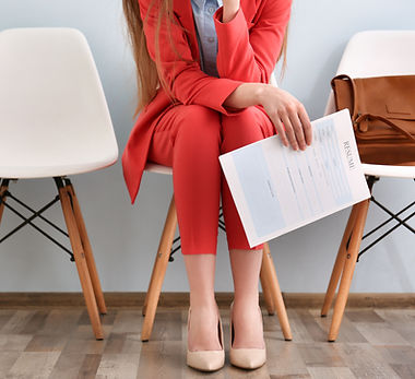 Young woman waiting for interview indoor