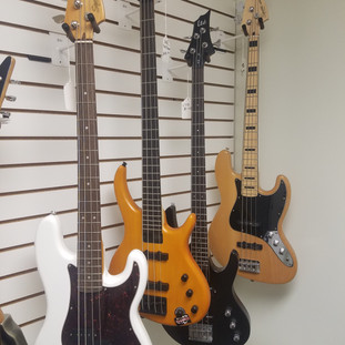 Bass Guitars: Fender Squire Used for $349.99, Toby Tobias Used for $299.99, LTD B-10 Used for $249.99, and Squire Jazz Used for $249.99!