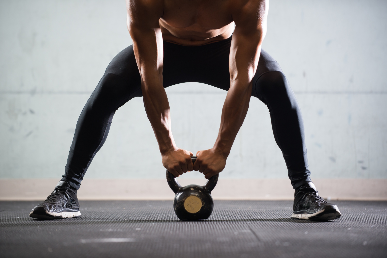 Muscular Man Lifting Kettle Ball_edited.