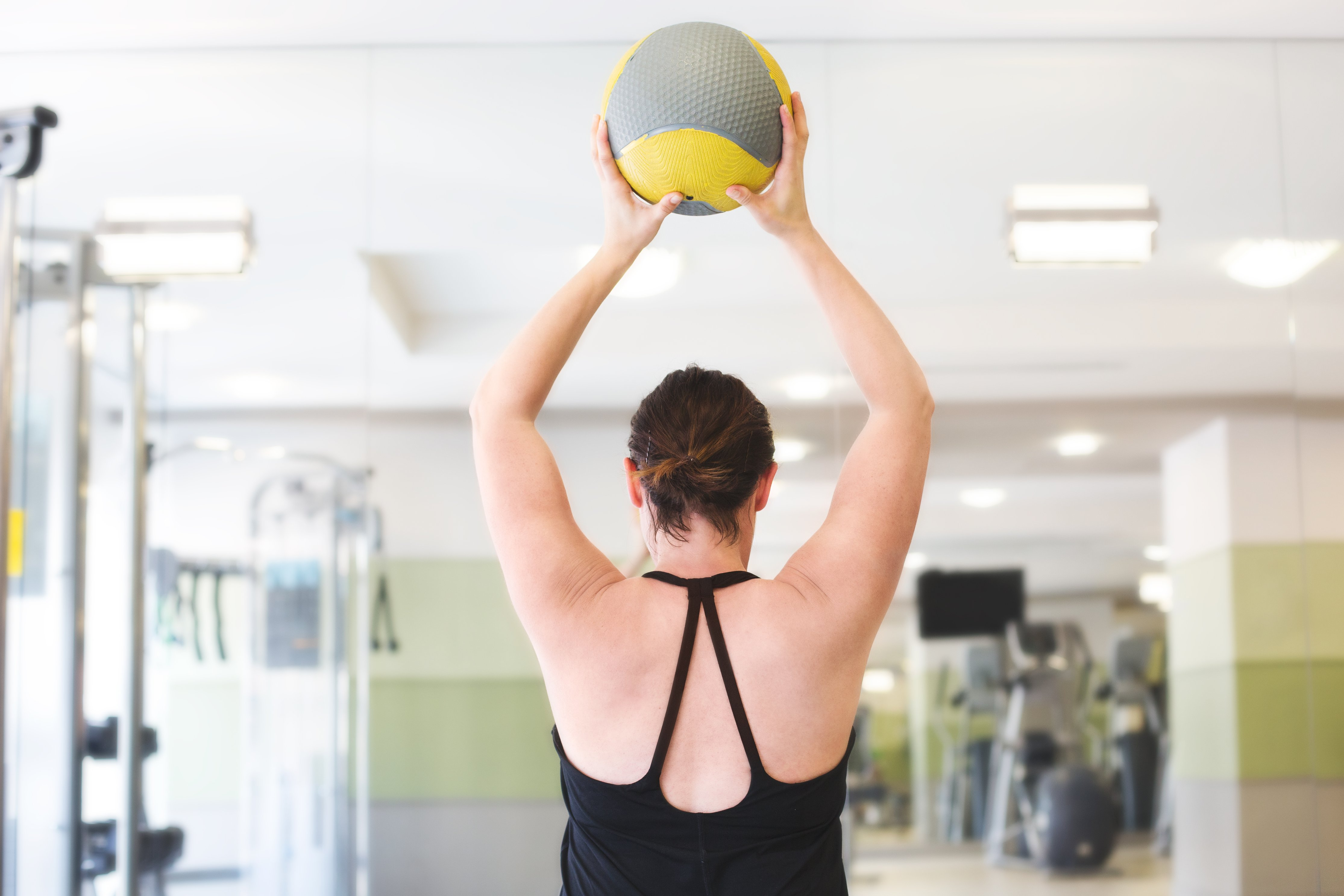 woman-lifting-fitness-ball