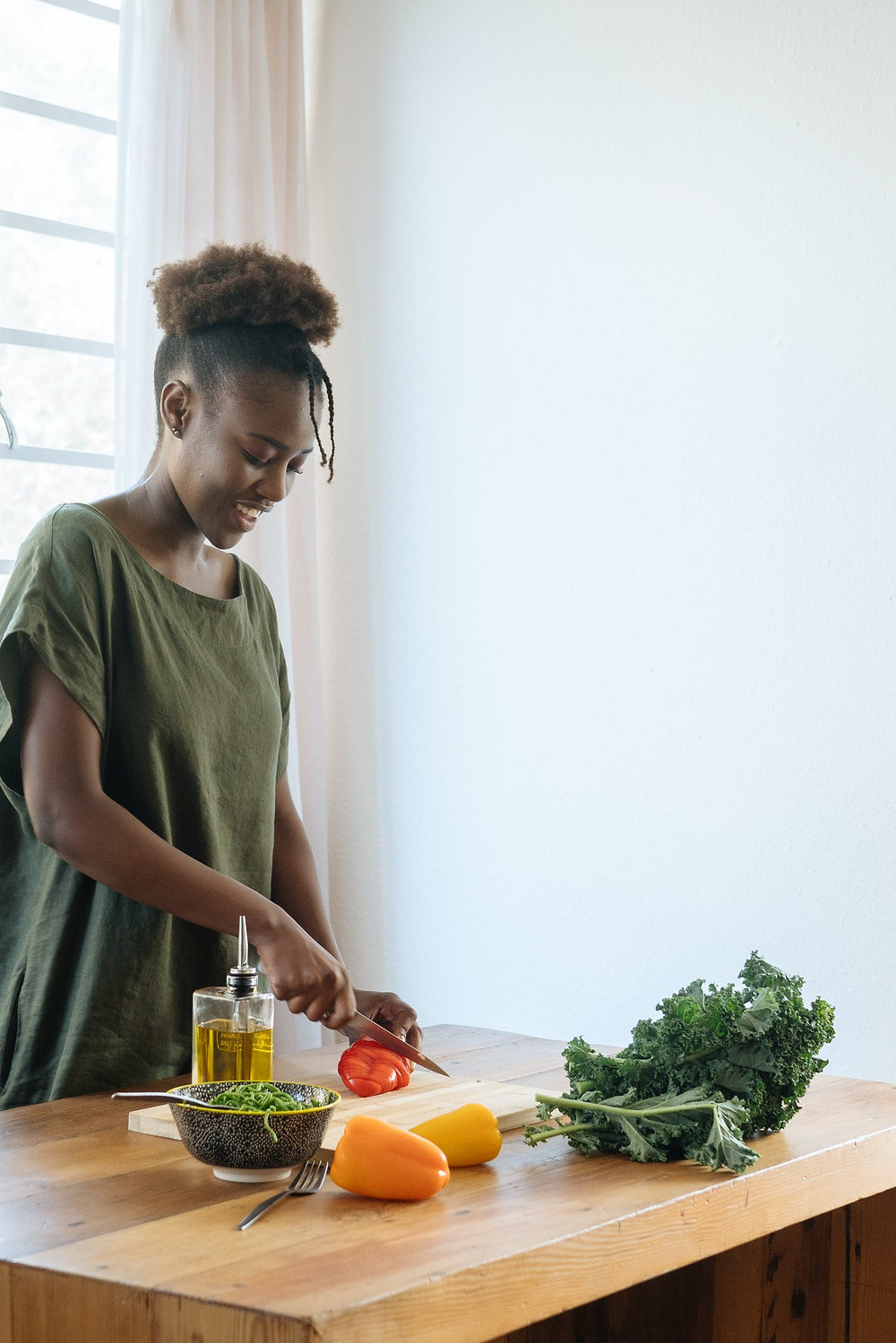 Woman In Green Crew Neck Dress Holding Green Vegetable