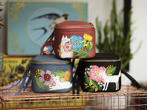 Hand-painted leather pouches/wristlet