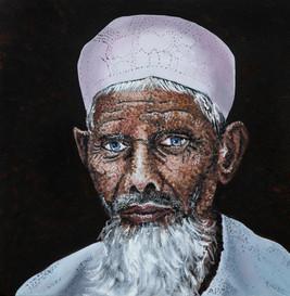 Muslim Man with a White Cap