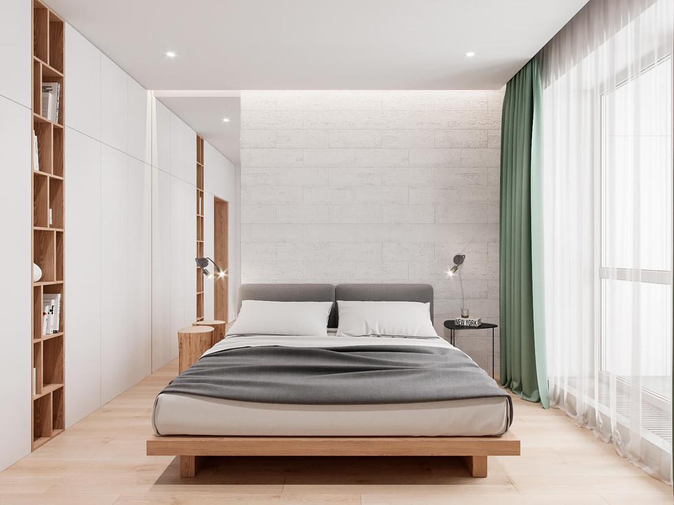 Вид на ліжко у спальній кімнаті.jpg