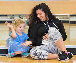 Teen Arts Associate with a young camper
