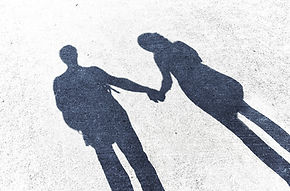 Shadow Couple Holding Hands
