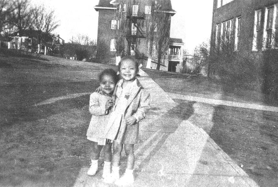 children infront of Long building.jpg