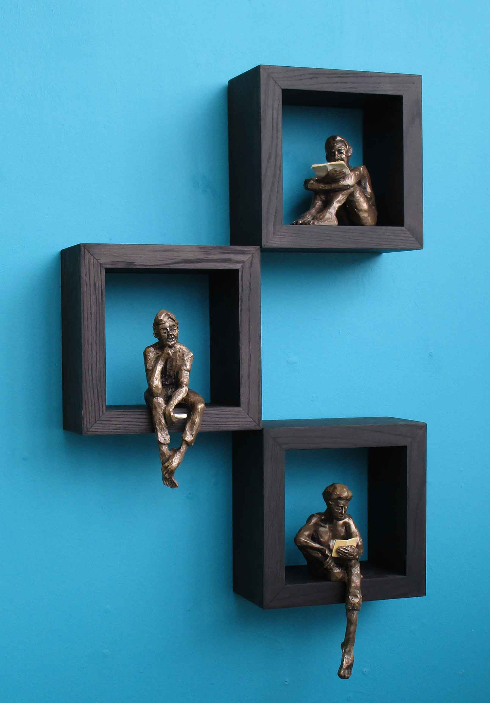 Guys reading on wall mounted boxes