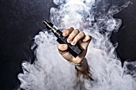 a-man-holding-an-e-cigarette.jpg
