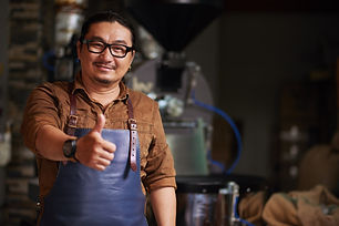 middle-aged-asian-man-posing-with-thumb-