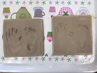 Fun hand and foot prints in clay