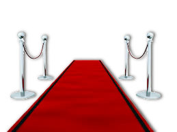 Red carpet with poles and red velvet ropes
