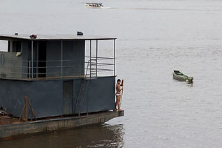 A boy takes a bath in Xingu River