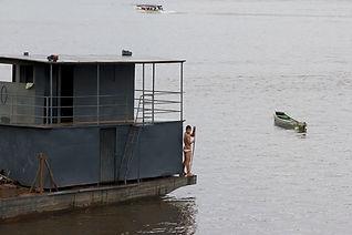 A boy takes a bath in Xingu River