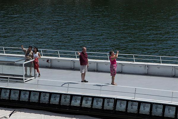People taking selfie in a boat on Seine river, in Paris