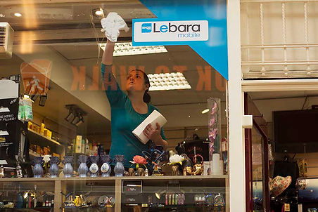 Woman cleaning store in Amsterdam