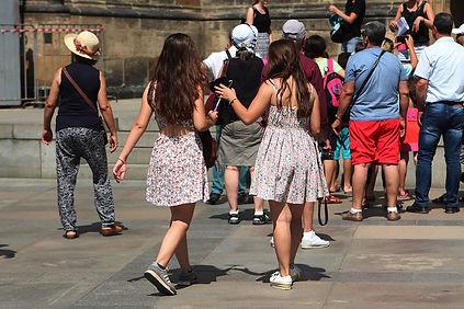 Girls wearing the same dress in prague