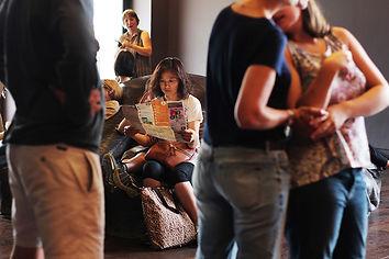 Woman reading newspaper in paris
