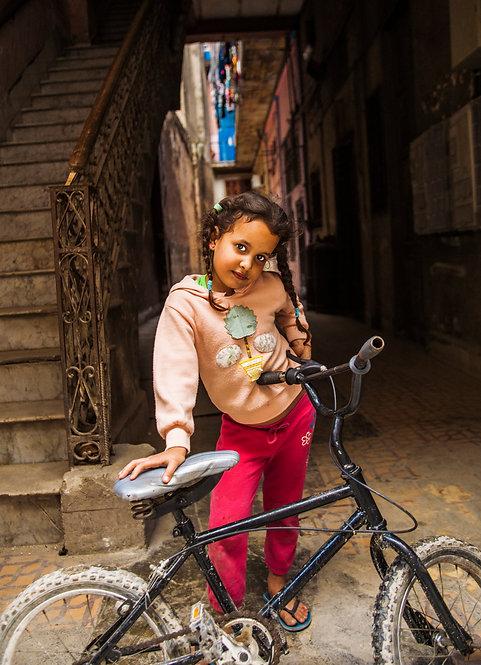 Girl With Her Bike in Havana Color