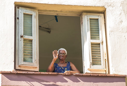 Woman Waving From Window in Havana