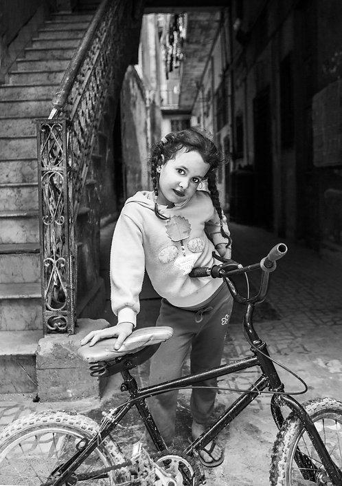 Girl With Her Bike in Havana BW