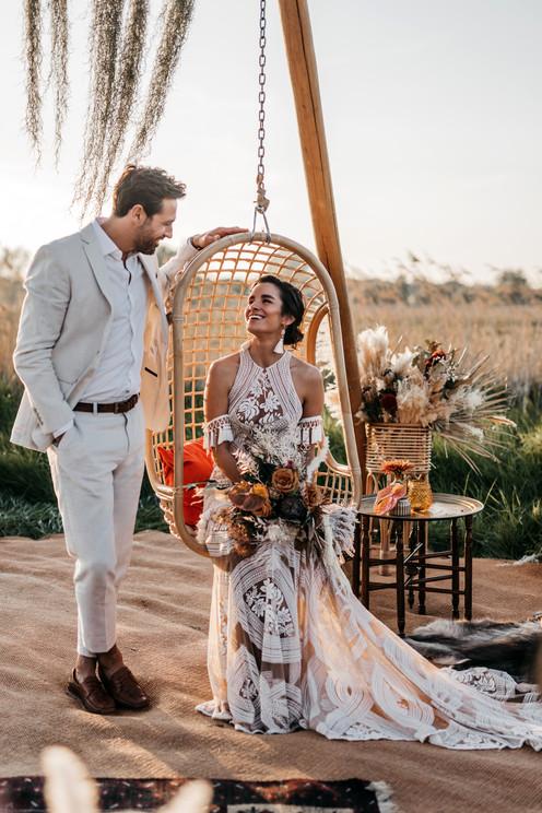 bride in Rue de seine dress and groom in white linen suit