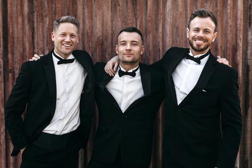 groomsmen wearing Moss Bros suits