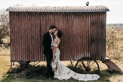 Bride and groom at the shepherd's hut wilderness weddings venue in Kent