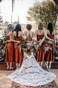 Rue de seine brides dress with bridesmaids in rust dresses with dried flower bouquets